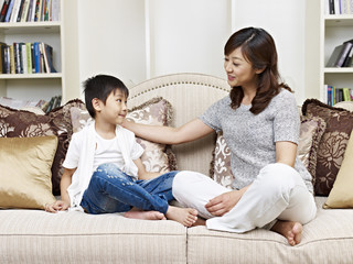 mother and son talking on couch