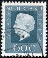 stamp printed in Netherlands shows portrait of Queen regnant