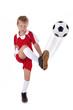 Junge schießt Fussball