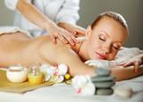 Fototapety Beautiful young woman getting spa massage
