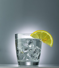 mineral water with ice and lemon close up