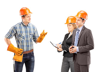 Manual worker having a conversation with architects