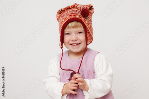 little girl wearing a hat