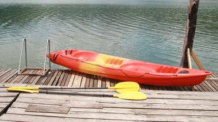 Red kayak on wood floor
