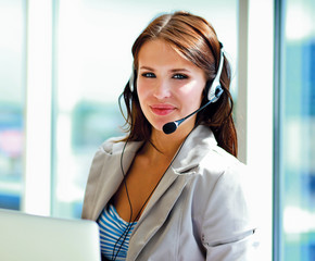 businesswoman talking on the phone with computer