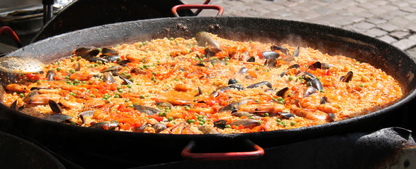 A Large Pan of Street Food Paella Being Cooked.
