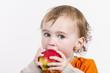 canvas print picture - young child eating red apple