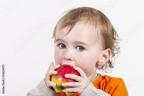 canvas print picture young child eating red apple