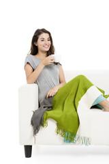 Drinking tea on the sofa