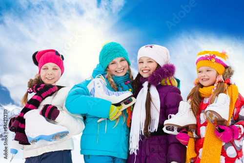 Four girls going ice skating