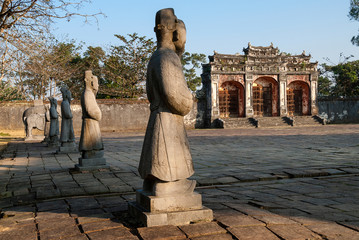 Statues and gateway in the old imperial city of Hue, Vietnam