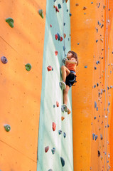 child studying climbing at the climbing centre