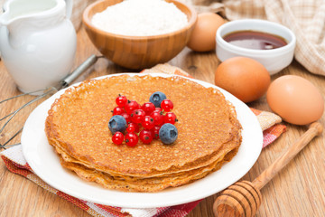 crepes with fresh berries and ingredients for baking