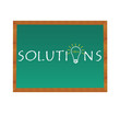 Pizarra para simbolizar Soluciones de una empresa