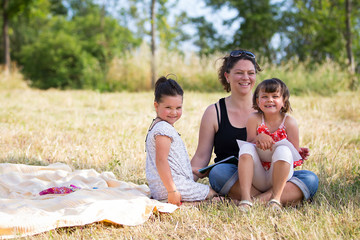 happy family smiling on the wheat at park, outdor potrait