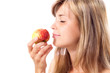 beautiful girl smelling a red juicy apple