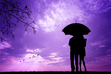 Couple with umbrella silhouette