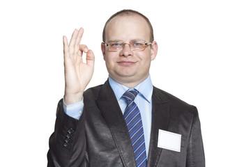 Businessman showing hand gesture ok