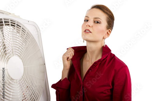 Businesswoman cooling off with a fan