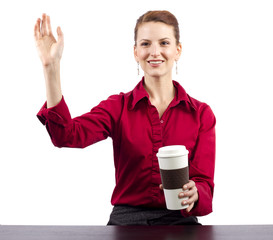 woman serving coffee behind the counter