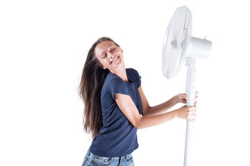 Young woman cooling herself under wind of cooler fan