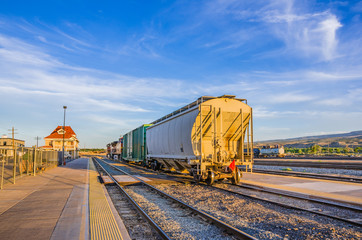 Goods Train at the Station at Sunset