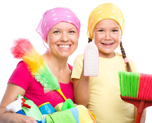 Mother and her daughter are dressed for cleaning