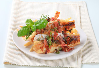 Pan fried fish fillets with fries