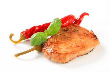 Pan-fried pork chop with chili peppers