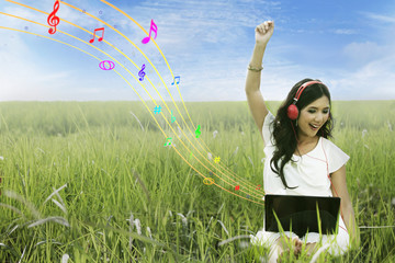 Happy woman singing on field