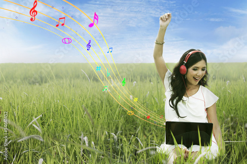 Happy woman singing on field