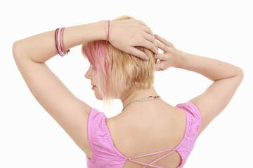 girl fixing hair nack to camera