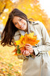 Fall / Autumn woman holding colorful leaves
