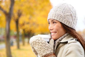Coffee drinking woman in Autumn fall enjoying fall