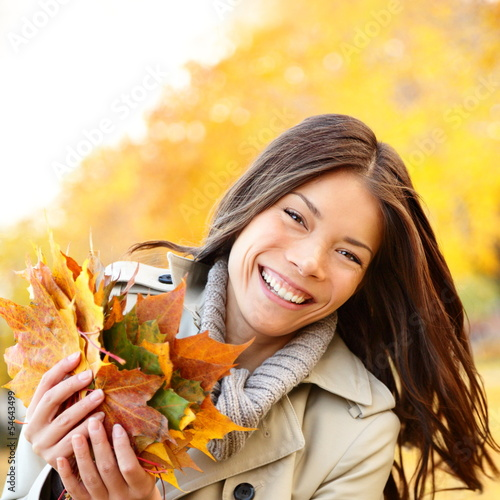 Autumn / Fall woman holding colorful leaves