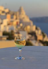 glass of wine at sunset in Santorini, Greece