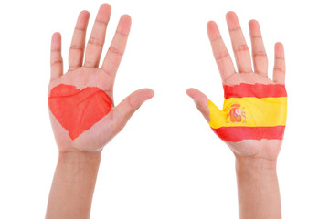 Hands with a painted heart and spanish flag, i love spain concep