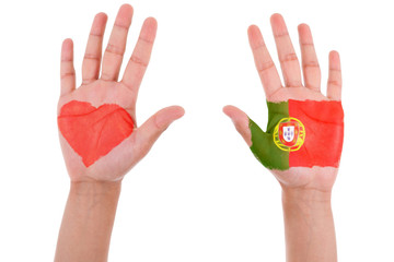 Hands with a painted heart and portuguese flag, i love portugal