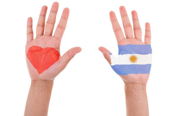Hands with a painted heart and argentinian flag, i love argentin