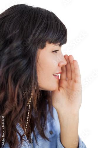 Brunette telling a secret