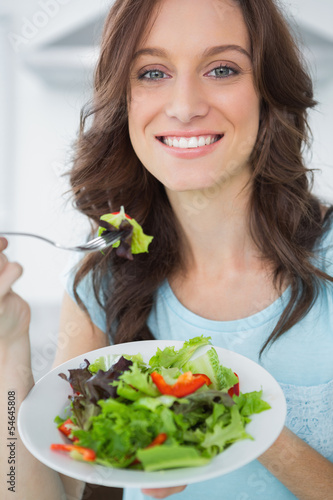 Brunette having salad