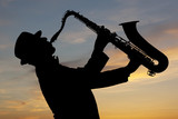 Fototapety Saxophonist at sunset
