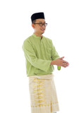 Malay male greetings during ramadan festival with isolated white