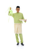 indonesian male with ketupat during ramadan festival with isolat