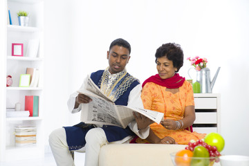 punjabi family mother and son reading newspaper with lifestyle s