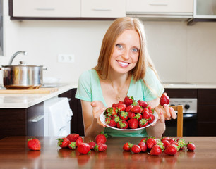 blonde housewife with fresh strawberries