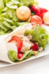 Tortilla wraps with meat and vegetables