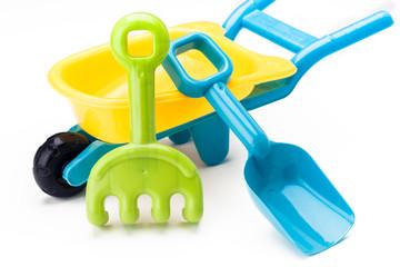 shovel rake and wheelbarrow toy on white base