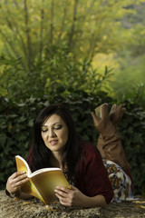 young woman reading on a park