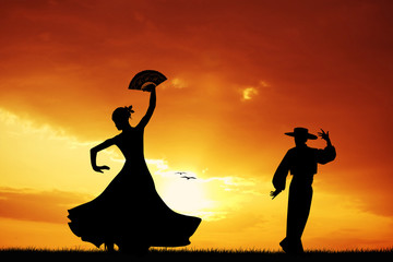 Flamenco dancers at sunset